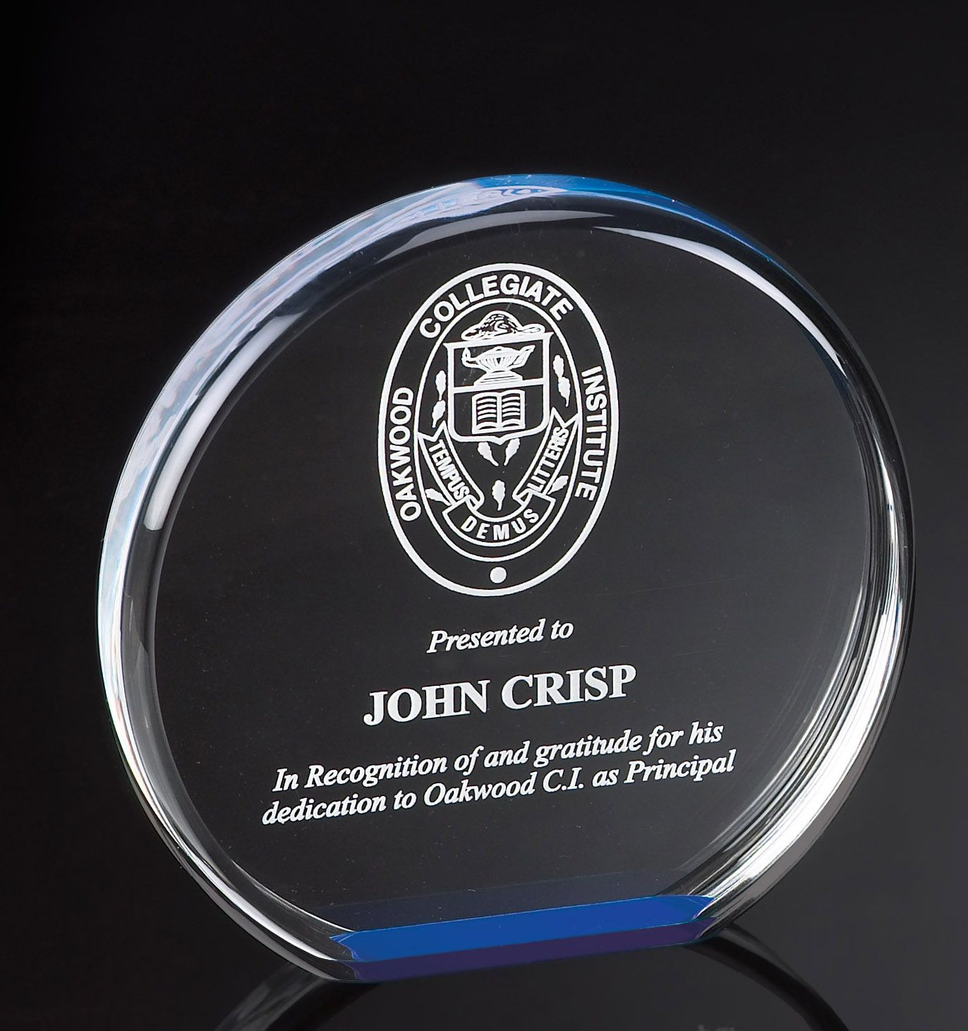 This unique acrylic award features a dramatic blue reflective base which illuminates the color throughout the circular shape.