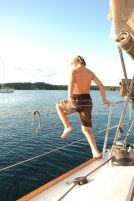 Alex swimming of the boat at anchor.