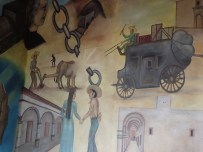 The Historical Mural wraps around & tells quite a story