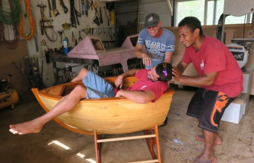 The carpenter Cyril trying out his last masterpiece - a boat shaped cradle