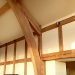 Lounge lighting with wooden beams 03 by Sam Coles Lighting
