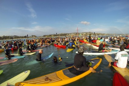 Hundreds gathered at Doheny State Beach, April 18 for a traditional Hawaiian paddle-out memorial for Hobie Alter who passed away March 29 at the age of 80. Photo by Emmy Lombard
