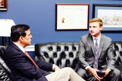 Former San Clemente High School Triton of the Year Quinn Hatoff speaks with Congressman Darrell Issa. Hatoff was awarded a Gold Medal from the Congressional Award Foundation for service. Andrew Boyd of San Clemente was also honored by the organization. Courtesy of Quinn Hatoff