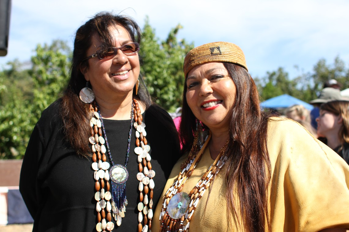 Event organizer Rebecca Robles and Jacque Tahuka-Nunez, a Native American storyteller and educator, pose together on Sunday.  Photo by Andrea Swayne