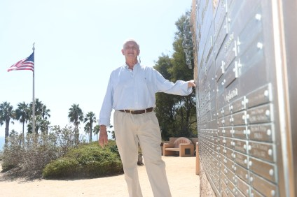 Eggleston stands next to the wall of names of park donors and honored military personnel. Photo: Eric Heinz