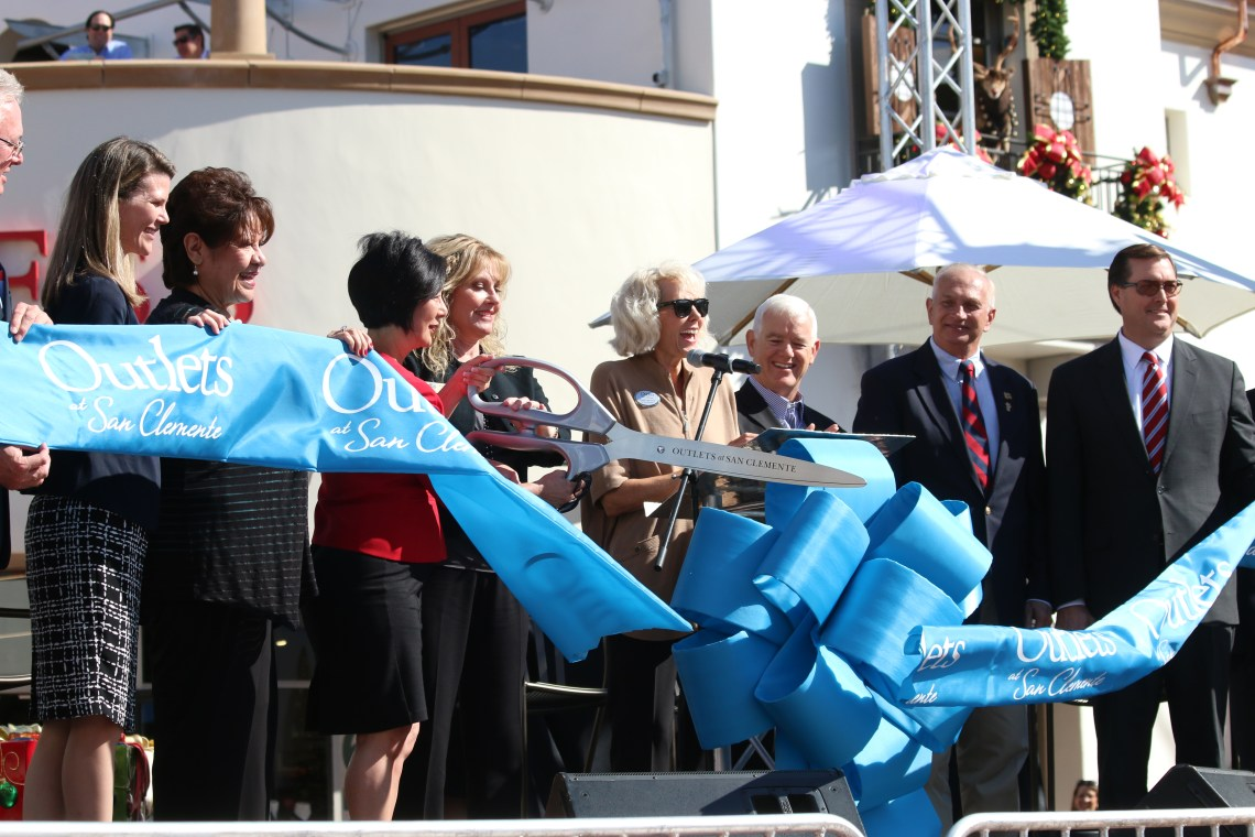 Legislative representatives, City Council members and Outlets at San Clemente officials cut the ribbon during a grand opening ceremony Thursday, Nov. 12. Photo: Eric Heinz