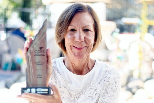 Carla Hogan, the founder of the San Clemente Marine Corps Support Group, holds her award from the California Parks & Recreation Society as one of the society's Champion of the Community. Photo: Eric Heinz
