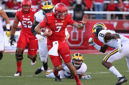 Travis Wilson runs the ball against Michigan during a game on Sept. 3, 2015. Photo: University of Utah Athletics