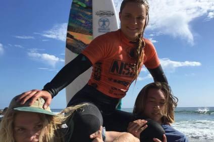 Kristina Hehl, 16, is hoisted after her NSSA High School Women's Junior Varsity title at Salt Creek in Dana Point this weekend. Photo: Kurt Steinmetz
