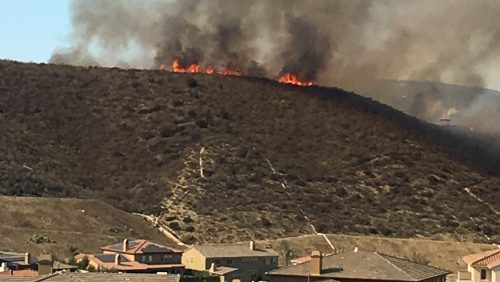 A brush fire came close to homes in a San Juan Capistrano subdivision on Sunday, Nov. 14. The fire grew to 50 acres before firefighters extinguished it. Photo: Courtesy of Joey Santley