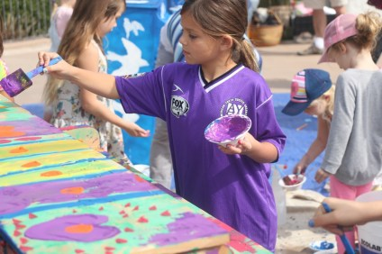 Children paint pianos during the Keys by the Sea event on Saturday, Feb. 25, at Casa Romantica. The pianos will be played by young musicians during an event on Sunday, March 5, at the Casa.