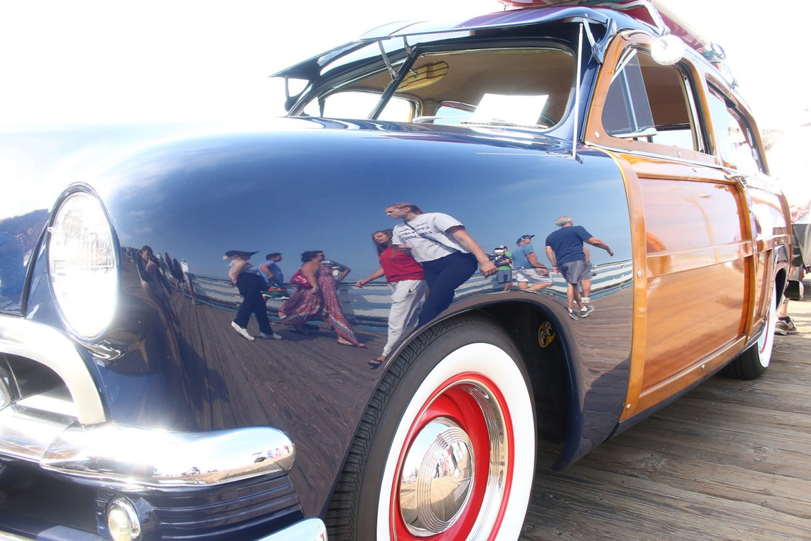 A classic woodie car sits on the San Clemente Pier during Ocean Fest. Photo: Eric Heinz