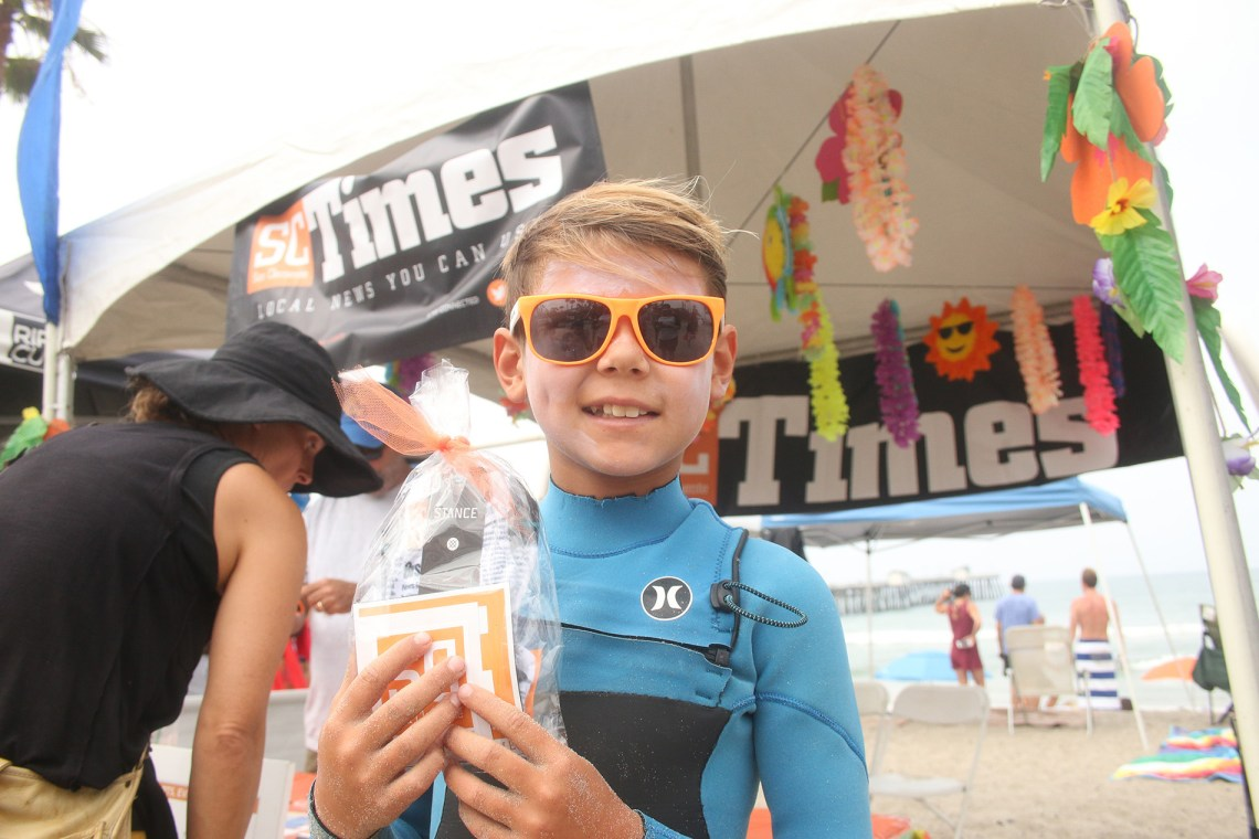 An Ocean Fest-goer stops by the San Clemente Times booth. Photo: Eric Heinz
