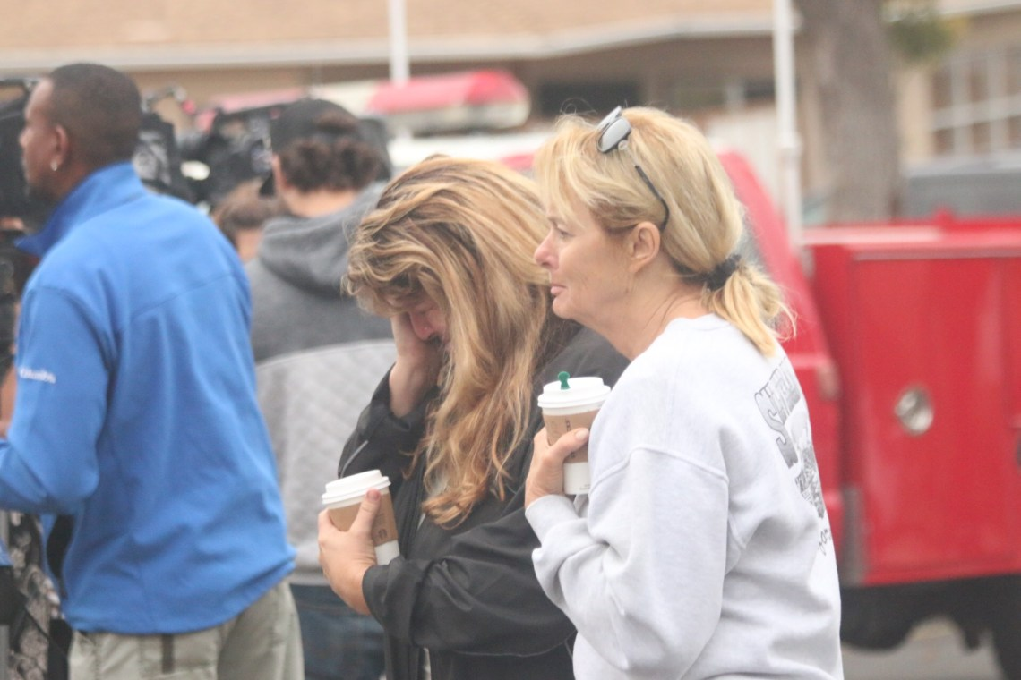 Diane Alajoki, left, is comforted by a friend after her garage exploded from a ruptured gas line early Thursday morning. Aug. 24. The cause of the rupture is still under investigation by OCFA. Photo: Eric Heinz