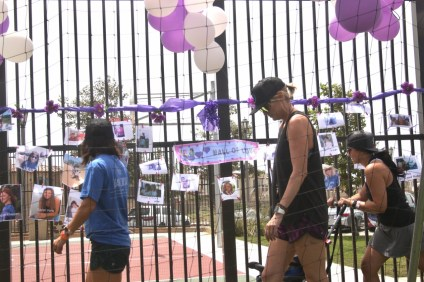 """People walked by the """"wall of love"""" with photos of people who died after battling cancer during the San Clemente Relay for Life on Saturday, Aug. 26, at Jim Johnson Memorial Sports Park. Photo: Eric Heinz"""