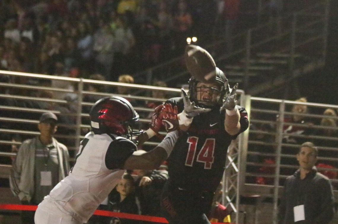 Jay Baggs hauls in a touchdown catch against Murrieta Valley. Photo: Eric Heinz