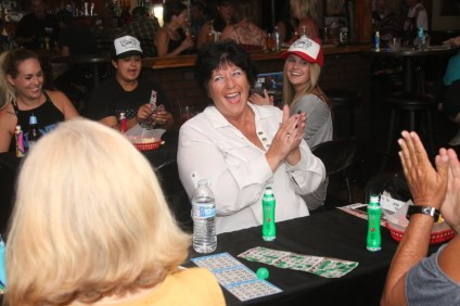 Tami Fusco, center, celebrates winning a round of bingo during the Goody's Tavern charity bingo night. On Oct. 2., the event raised more than $650 for the San Clemente Skatepark Coalition. Photo: Eric Heinz