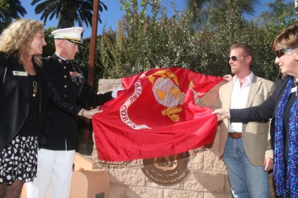 City officials and members of the military unveil the 2/4 plaque on Nov. 4 at Park Semper Fi.