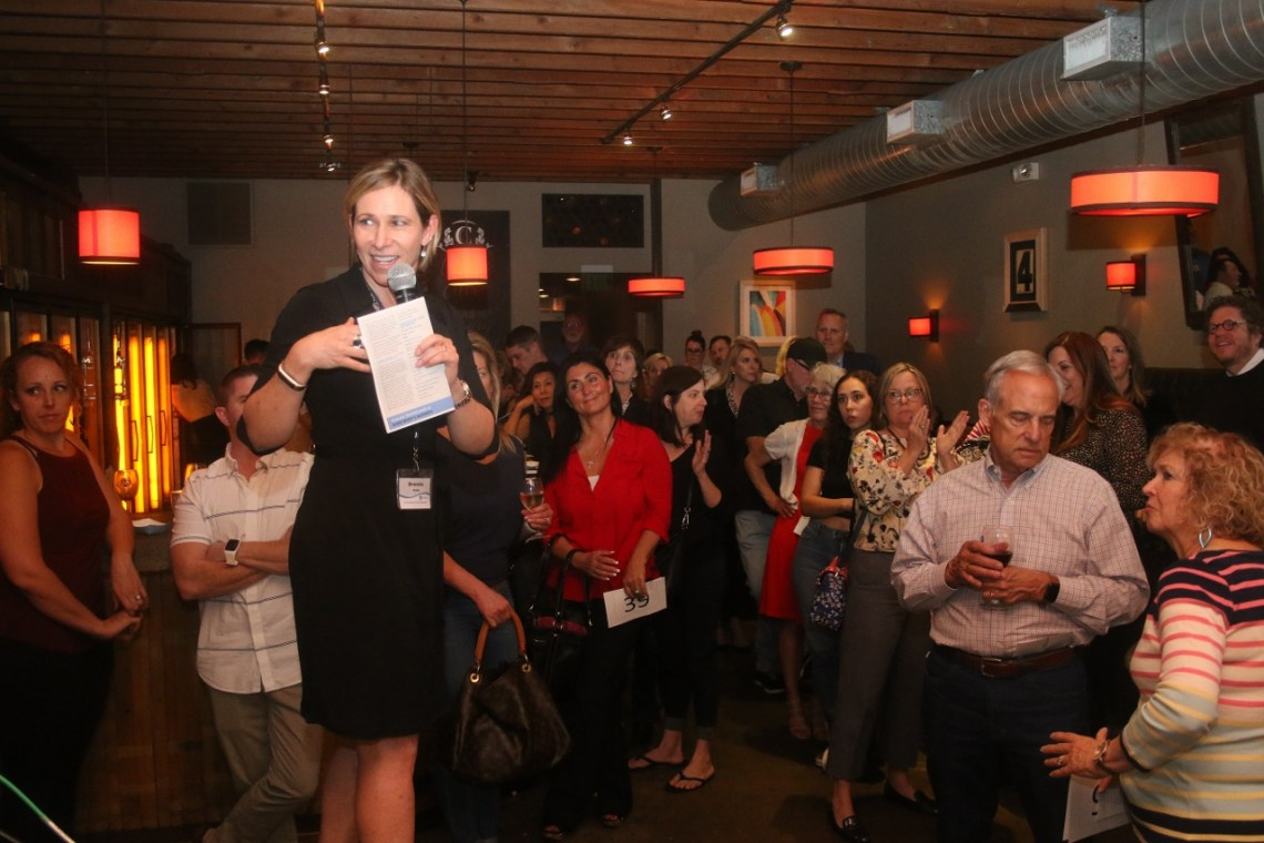 Brenda Wells speaks to the audience at the Be a Big Cheese event on Jan. 29 at The Cellar in San Clemente. Photo: Eric Heinz