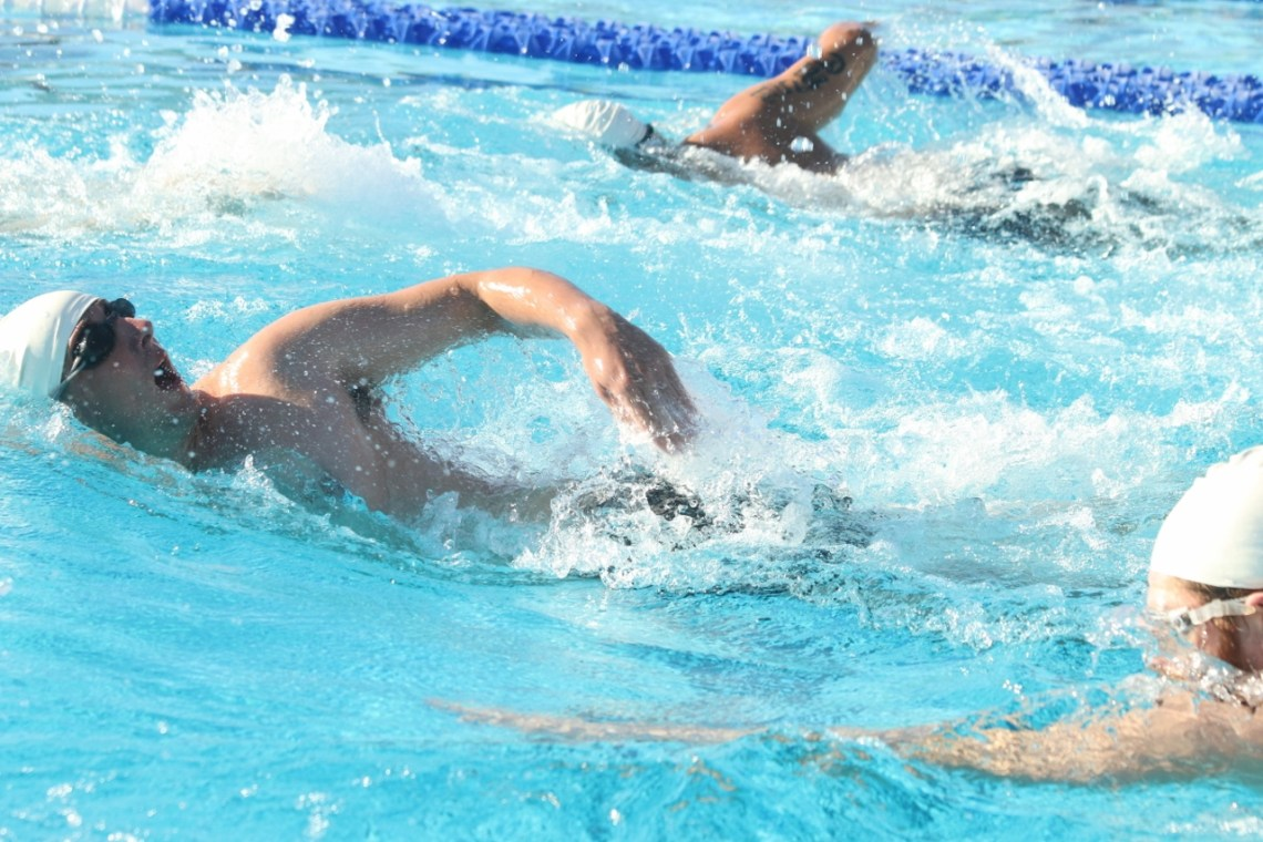 Players swim toward the torpedo as the second game starts between San Clemente and Oceanside on Jan. 27 at the San Clemente Aquatics Center.