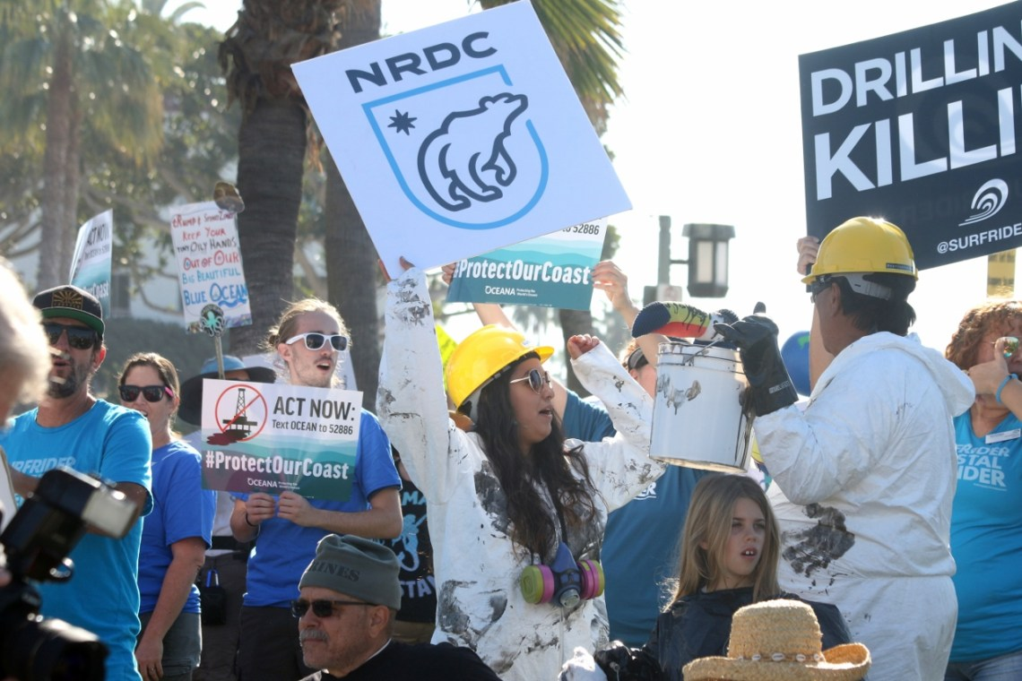 "Many people who attended the Feb. 3 protest in Laguna Beach dressed in ""oil""-covered jumpsuits to convey their message about effects of opening offshore oil and gas extraction. Photo: Eric Heinz"