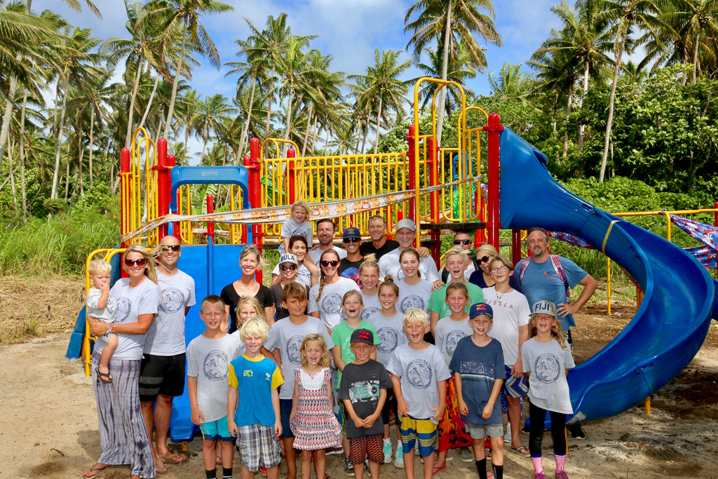 Better Together Ministries families of San Clemente pose for a photo in November in Fiji after bringing playground equipment and other needs to the area. Photo: Courtesy of Stephanie Lavik