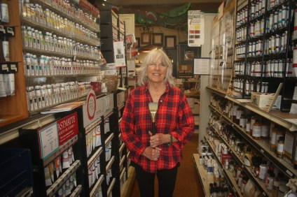Patti Herdell, the owners of San Clemente Art Supply, poses for a photo in April while celebrating 15 years in business. Photo: Eric Heinz