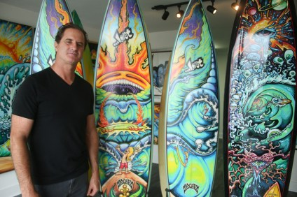 San Clemente artist Drew Brophy stands next to several surfboards for which he made the artwork while they're still in his studio, located at 139 Avenida Granada in San Clemente.
