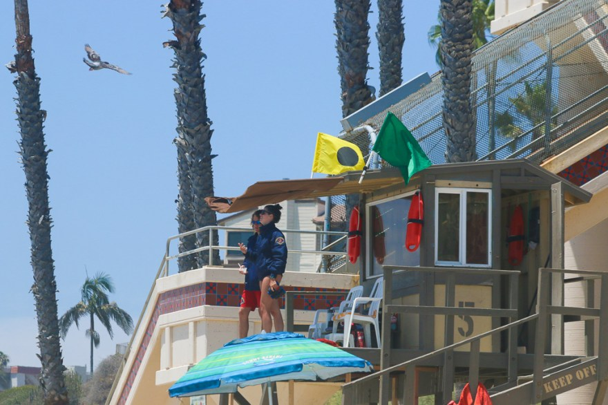 Two San Clemente lifeguards watch over T-Street Beach on June 15. The City Council will decide whether to start a trial period for 'soft-boards' less than 8 feet in length on June 19 at its regularly scheduled meeting. Photo: Eric Heinz