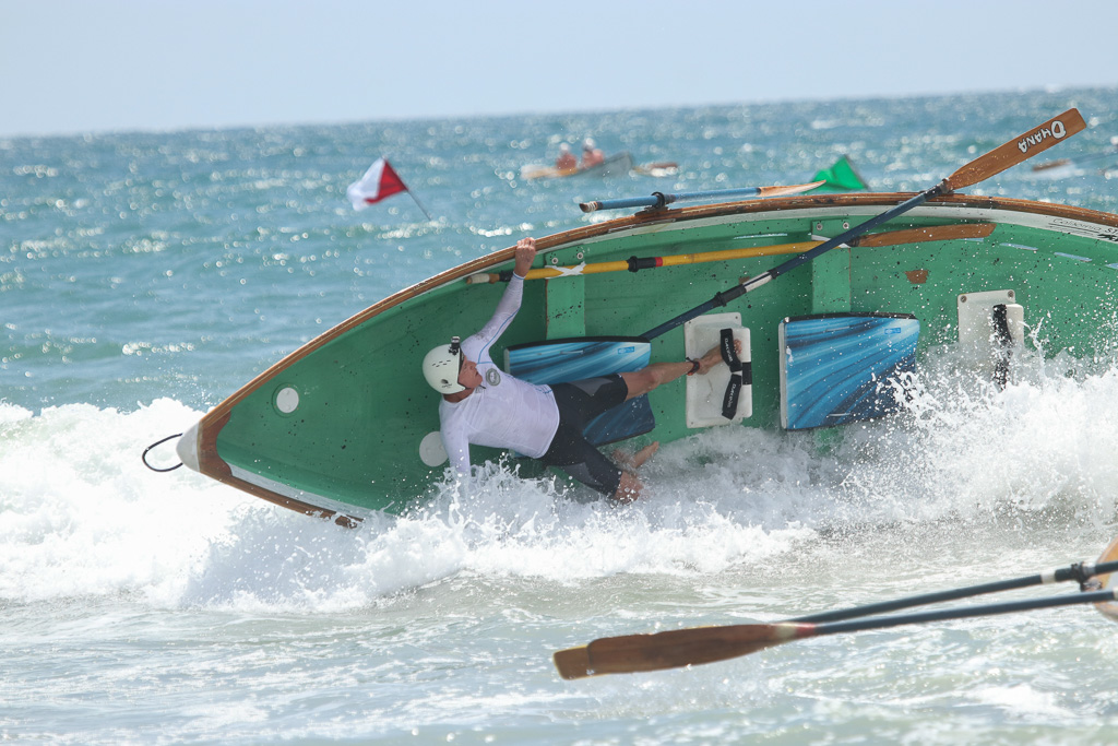 The Dory boat races were met with a surprisingly high surf right as they got started in the first heat (and the second heat, pictured, also threw in some waves) on Saturday, July 21, at the San Clemente Ocean Festival. Photo: Eric Heinz
