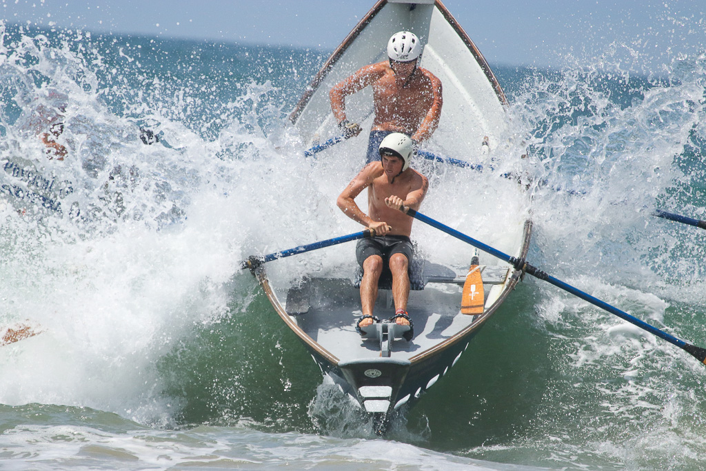 The Dory boat races were met with a surprisingly high surf right as they got started in the first heat on Saturday, July 21, at the San Clemente Ocean Festival. Photo: Eric Heinz