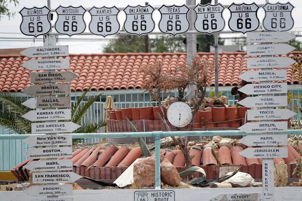 Arrows displayed at El Rancho Motel in Barstow point to many parts of the world but not to San Clemente, which is 204 railroad miles from the desert community. Photo: Fred Swegles