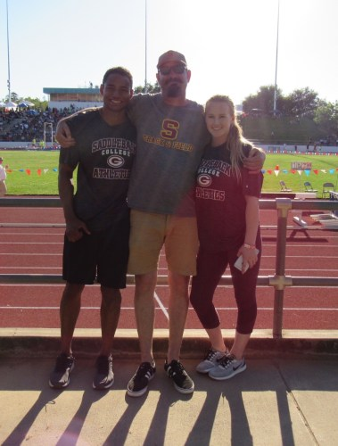 Anna Gillis (right) and Eric McArthur Jr. (left) stand with Saddleback College throwing coach Shaun McGinley. Gillis and McArthur met, began dating and earned scholarships to the University of Wyoming through competing at the hammer throw at Saddleback College. Photo: Courtesy