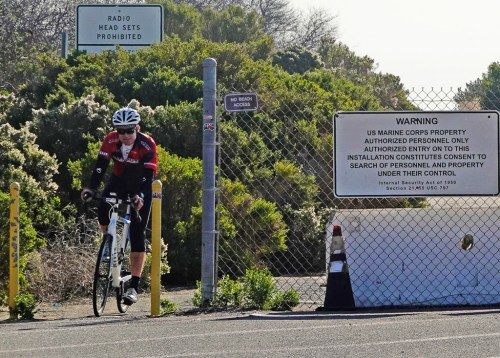 A northbound cyclist exits Camp Pendleton's designated bike trail, entering San Onofre State Beach heading upcoast. Camp Pendleton's bike trail provides a vital link between Oceanside and San Clemente. Photo: Fred Swegles
