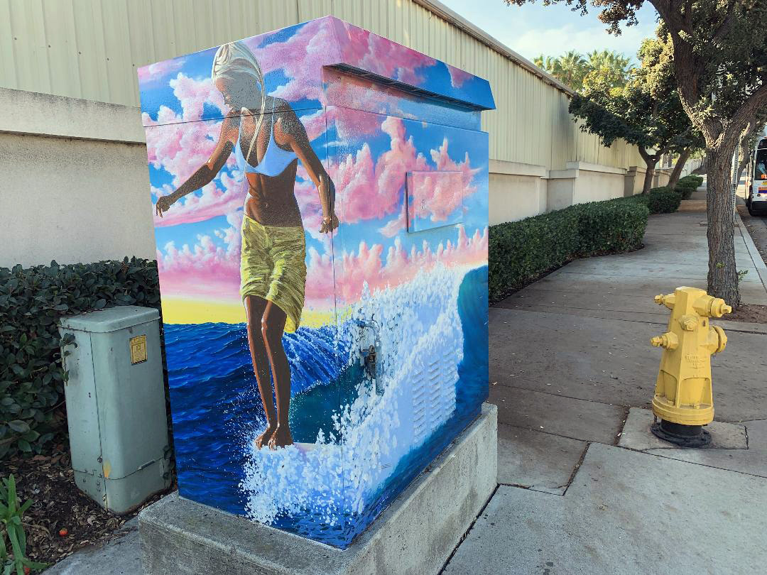 """Artist James Parkhurst, titled """"Water Dance,"""" on Avenida Pico at Calle de los Molinos as part of a city campaign to decorate traffic signal control boxes. Photo: Fred Swegles"""