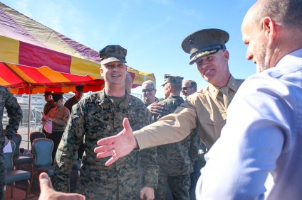 Lt. Col. Patrick Byrne, center, shakes the hand of a ceremony patron at Camp Pendleton on Jan. 25. Byrne is the new battalion commanding officer of the 2nd Battalion, 4th Marines. Photo: Eric Heinz