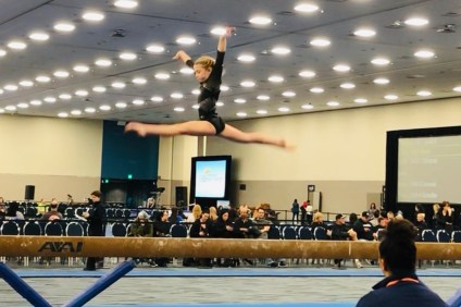 Madelyn Snedeker of San Clemente was the Level 6 beam champion for Olympica Gymnastics with a score of 9.875. She was also the floor exercise champion. Photo: Meaghan Snedeker