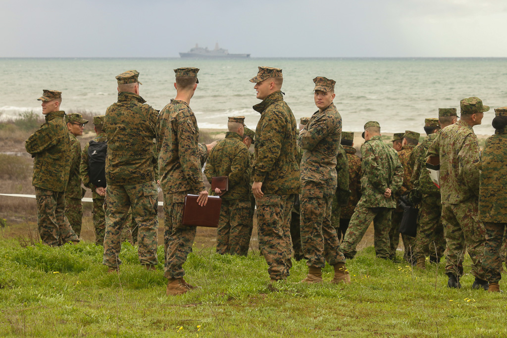 Japanese and American soldiers view the amphibious landing exercises at Camp Pendleton on Feb. 4. Photo: Eric Heinz
