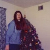 Our first Christmas tree, four months after our wedding. Notice the zebra print drapes my mother made us,