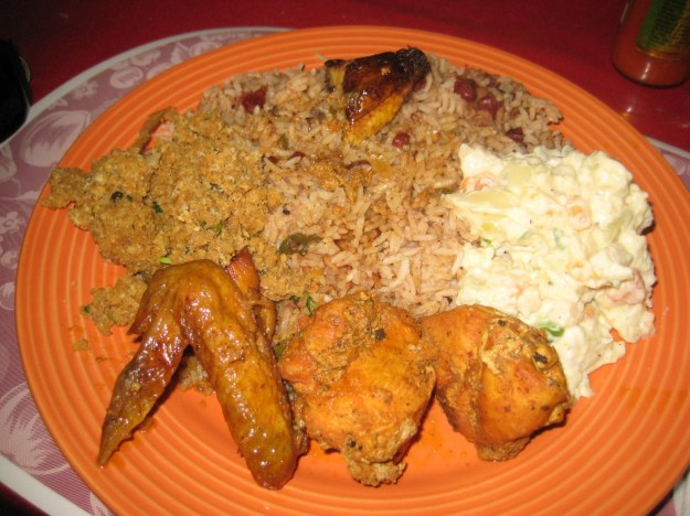 that stew chicken with rice and beans is the national dish of Belize ...