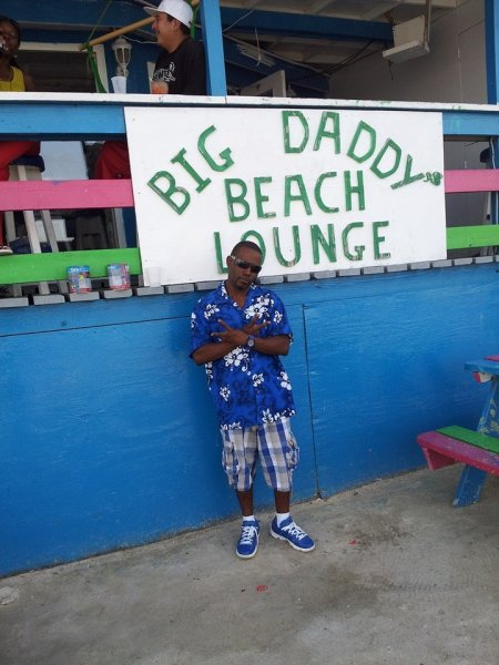 """""""Smurf"""" posing in front of Big Daddy's Beach Lounge"""