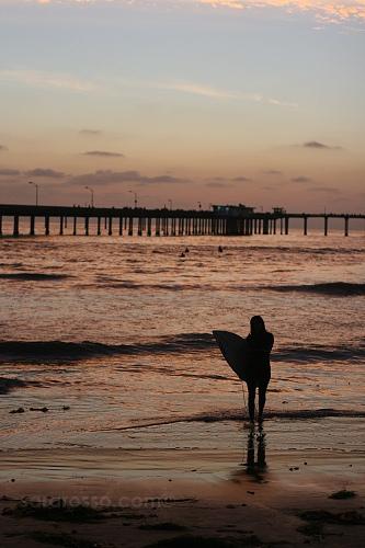 Surfer Girl at Ocean Beach, San Diego, California