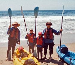 kayaking family on beach