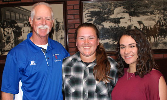 San Marcos coach Jeff Swann is joined by senior Hailee Rios and junior Hailey Fryklund.