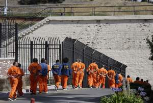 A row of general population inmates walk in a line at San Quentin State Prison. Credit: AP/Eric Risberg