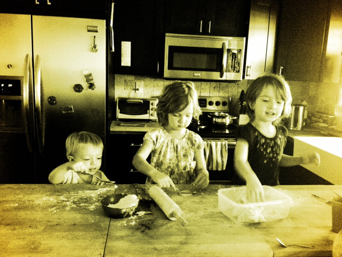 My three kids helping in the kitchen