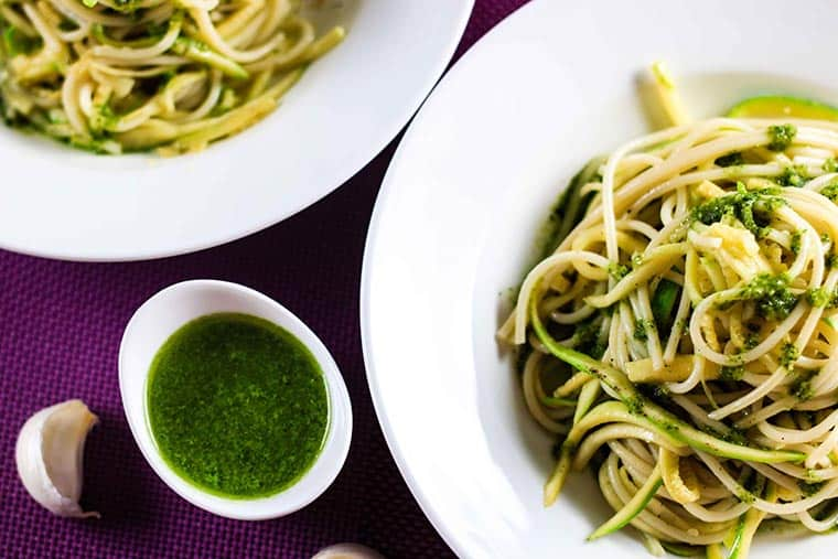 Zucchini Spaghetti with Pesto Sauce - This has definitely got to be the yummiest pesto sauce recipe out there! This dish is light, healthy and absolutely delicious. I'm sure you'll love it! | ScrambledChefs.com