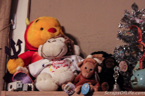 Up on top of the doll shelf, along with Devil Pooh, sit a few of our smaller monkeys.