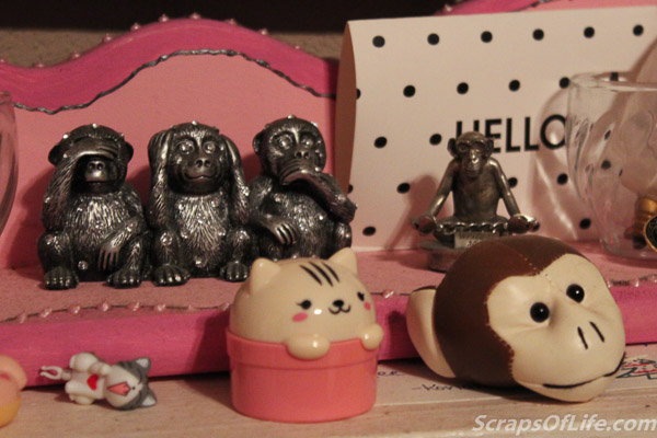 Some of the non-plush monkeys are on my mantle--first the blingy three wise monkeys and then the penholder that says 'Write No Evil'