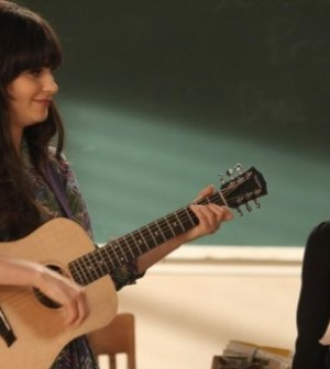 Jess (zooey Deschanel) tires music as a remedy to bullying in New Girl. Image © Fox Broadcasting